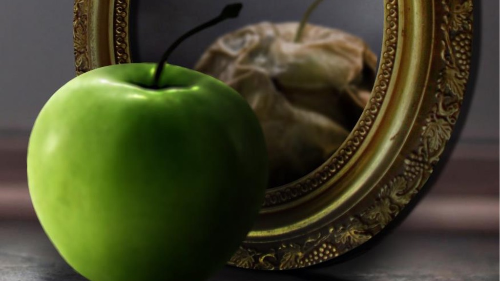 Fresh apple reflected rotten in mirror